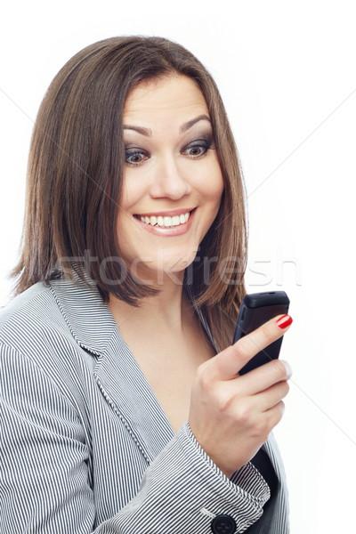 Kellemes sms örvend hölgy olvas küldés Stock fotó © Novic