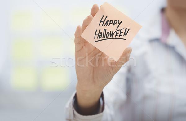 Woman holding agenda with Happy Halloween text Stock photo © Novic