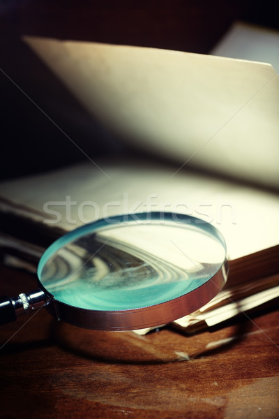 Old book and magnifier Stock photo © Novic