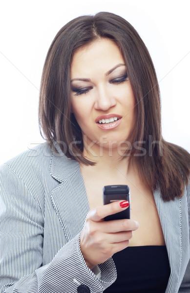 Nudny sms kobieta interesu czytania komórka telefon Zdjęcia stock © Novic