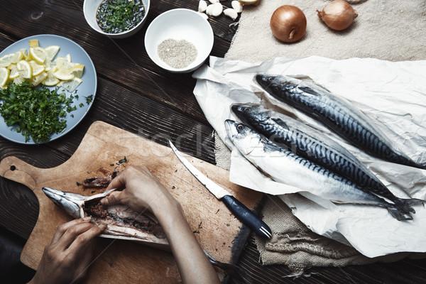 Woman preparing mackerel fish Stock photo © Novic