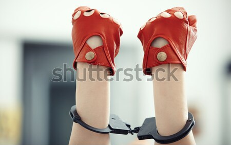 Hands in wristlets Stock photo © Novic