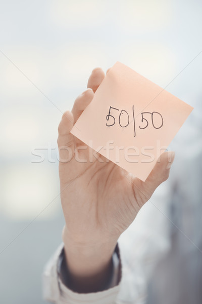 Fifty-fifty text on adhesive note Stock photo © Novic