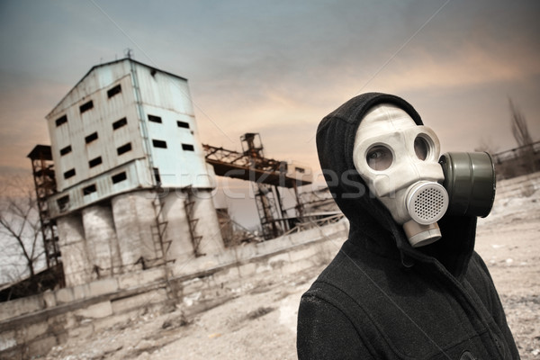 Human in gas mask outdoors and industrial factory on a background Stock photo © Novic