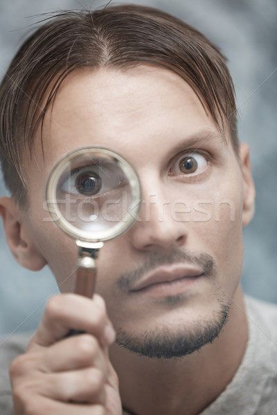 Man with magnifying glass Stock photo © Novic