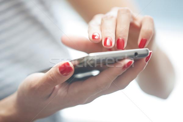 Nő okostelefon piros manikűr vízszintes fotó Stock fotó © Novic