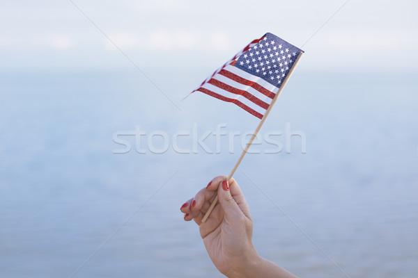 Woman waving US flag Stock photo © Novic