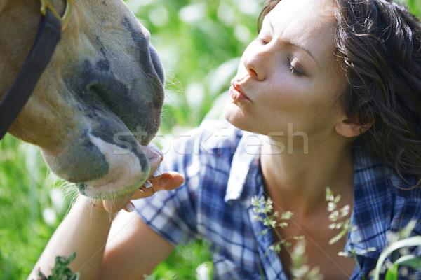 Woman and horse together at paddock Stock photo © Novic