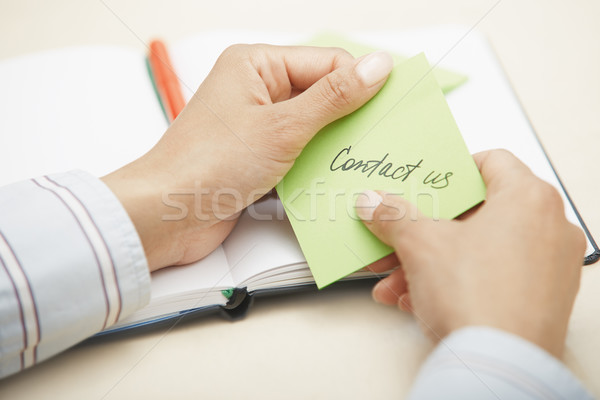 Contact us text on adhesive note Stock photo © Novic