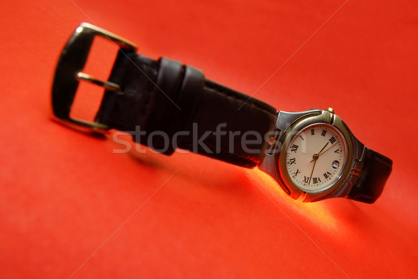 Watch on a red Stock photo © Novic