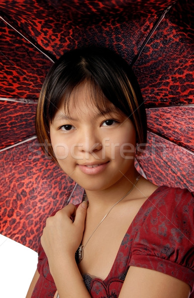 Young model with red spotty umbrella  Stock photo © Novic