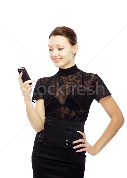 Sms mosolyog hölgy olvas mobiltelefon fehér Stock fotó © Novic