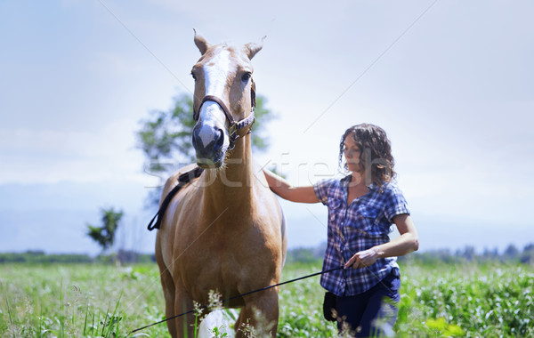 Stock photo: Woman training her horse