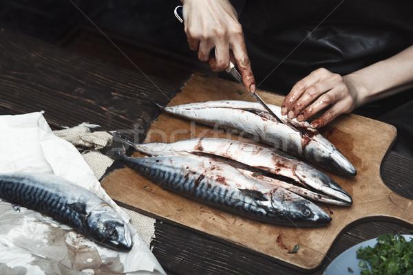 Nő makréla hal kéz asztal tábla Stock fotó © Novic