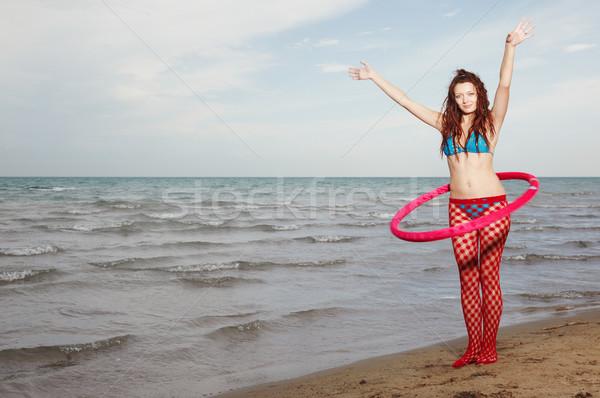 Bayan kırmızı açık havada oynama plaj uygunluk Stok fotoğraf © Novic