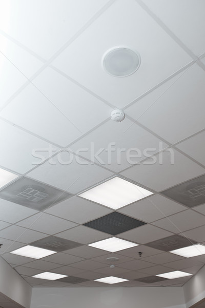 Office room ceiling with smoke detector and alarm Stock photo © Novic