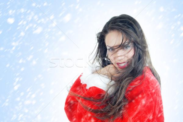 Happy female Santa in snowstorm Stock photo © Novic