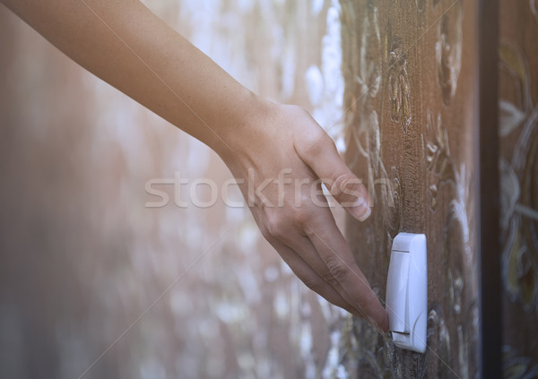 Woman turning on or off electric switch Stock photo © Novic