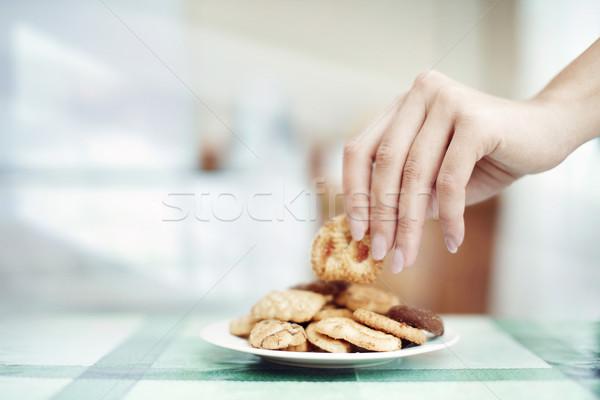 Taking cookie Stock photo © Novic