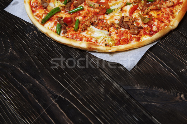 Homemade pizza on a wooden table Stock photo © Novic