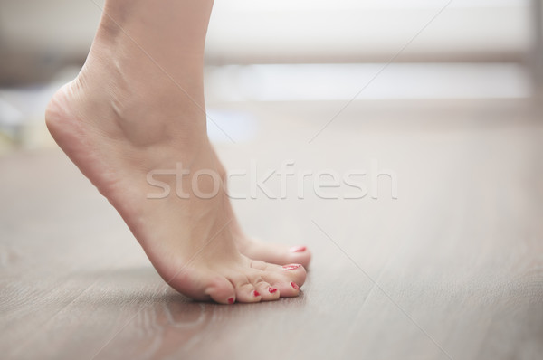 Woman standing on tiptoe Stock photo © Novic