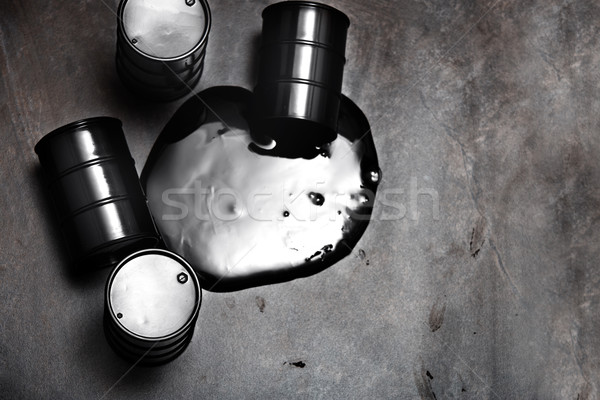 High angle view on four fuel barrels with spilled oil Stock photo © Novic