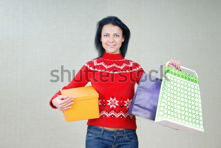 Stock photo: Woman showing the bags with gifts