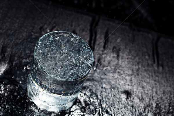 Water glass on a wet table Stock photo © Novic