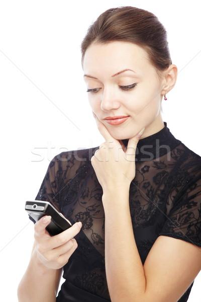 Sms gondolkodik hölgy mobiltelefon olvas lány Stock fotó © Novic