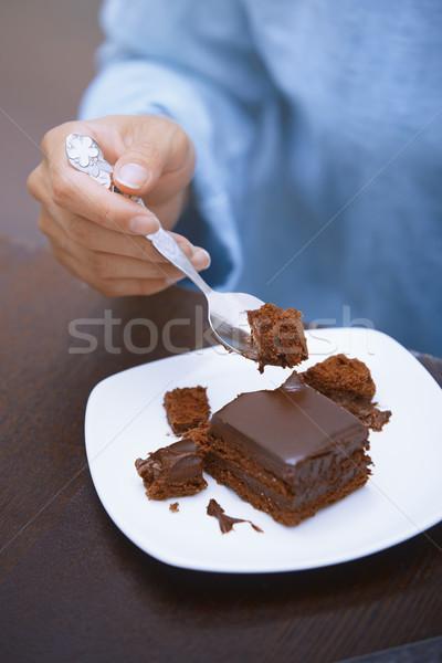 Woman eating chocolate cake  Stock photo © Novic