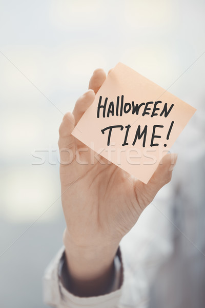 Woman holding agenda with Halloween time text Stock photo © Novic