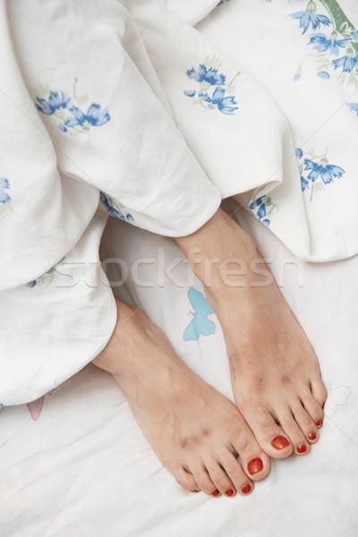 Láb nő közelkép gyógyszer ágy kukorica Stock fotó © Novic