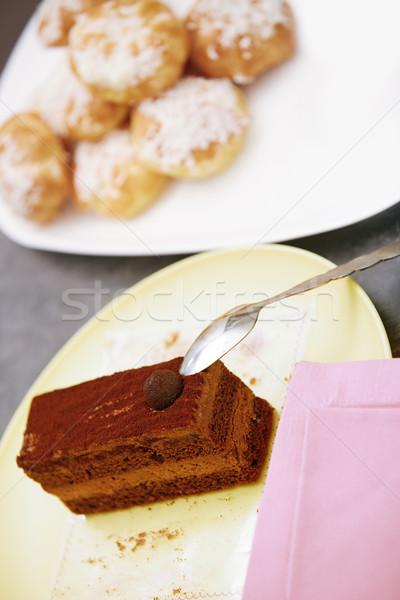 Chocolate cake and eclairs Stock photo © Novic