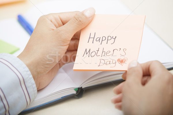 Ręce karteczkę tekst działalności Zdjęcia stock © Novic