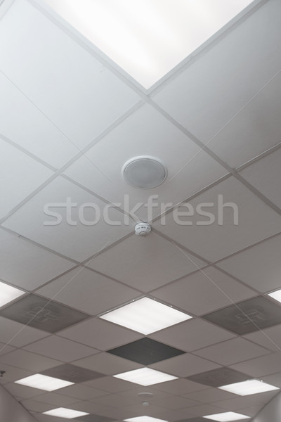 Stock photo: Office room ceiling with smoke detector and alarm
