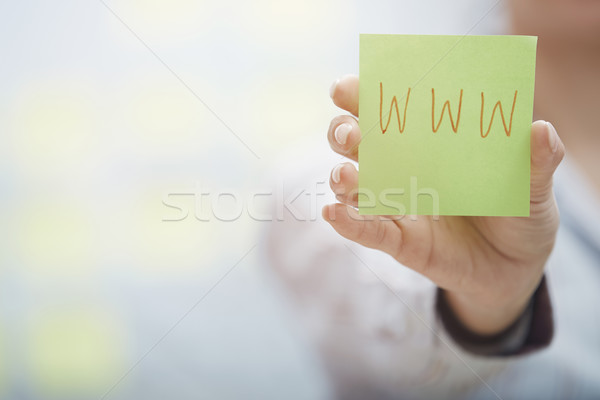 Hands holding sticky note with internet address Stock photo © Novic