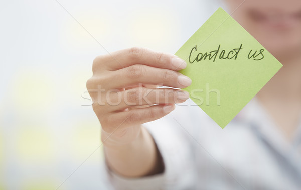 Contact us on adhesive note Stock photo © Novic