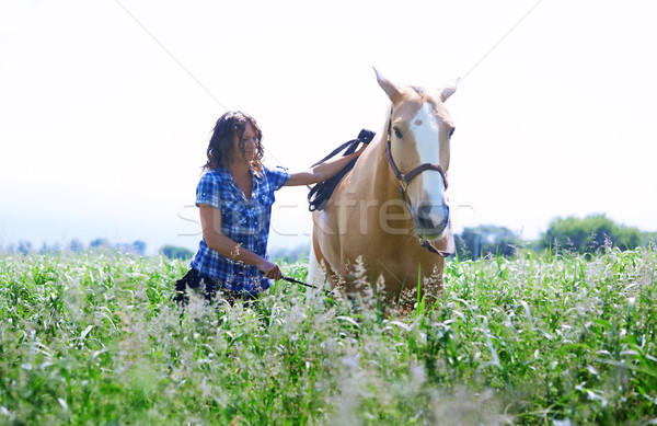 Woman training her horse Stock photo © Novic