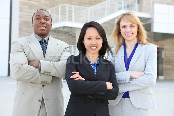 Ethnic Business Team  (Focus on middle woman) Stock photo © nruboc
