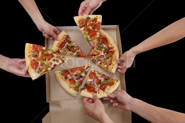 Persone mangiare pizza persone gruppo fette Foto d'archivio © nruboc