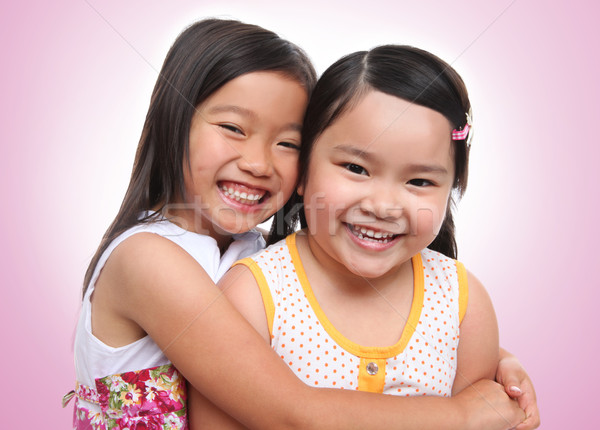 Two asian young sisters hugging Stock photo © nruboc