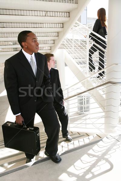 Geschäftsmann Verfolgungsjagd Business Frau Büro Gebäude Stock foto © nruboc