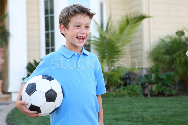 Stock photo: Young Boy with Soccer Ball