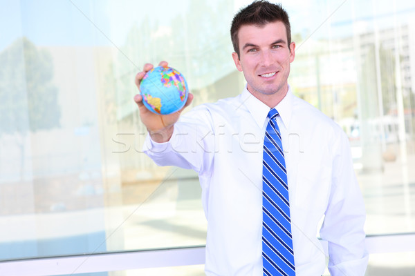 Handsome Business Man with Globe Stock photo © nruboc