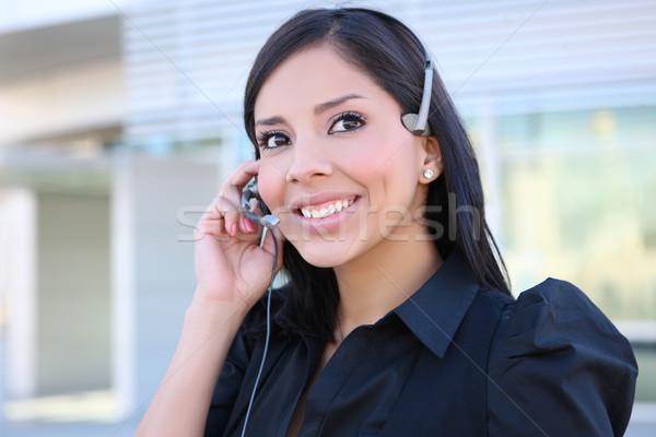 Ispanico donna d'affari telefono bella servizio di assistenza faccia Foto d'archivio © nruboc