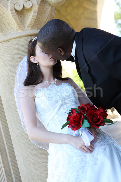 Interracial Wedding Couple Kissing Stock photo © nruboc