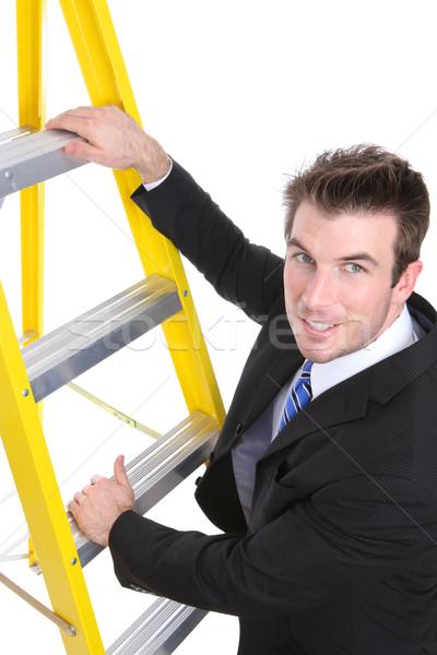 Handsome Business Man on Ladder Stock photo © nruboc