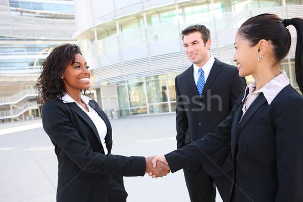 Diverso atraente equipe de negócios homem mulher aperto de mão Foto stock © nruboc