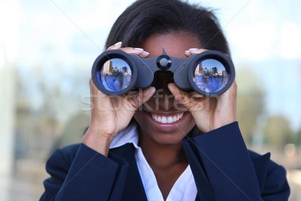 Afrikaanse vrouw verrekijker mooie afro-amerikaanse zakenvrouw Stockfoto © nruboc