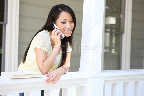 Mooie asian meisje telefoon home jonge vrouw Stockfoto © nruboc